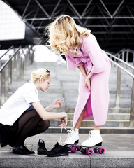 girl  stylist works on creation of an image for  photoshoot