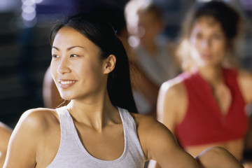 Asian woman in exercise class