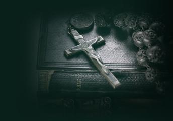 Cross crucifix on a bible