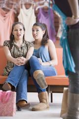 Multi-ethnic teenaged girls clothes shopping