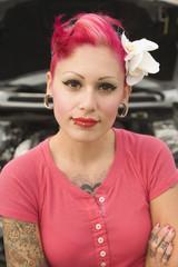 Tattooed Hispanic woman with arms crossed