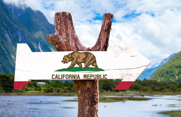 California Flag wooden sign with mountains background