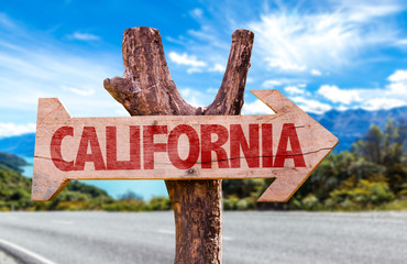 California wooden sign with road background