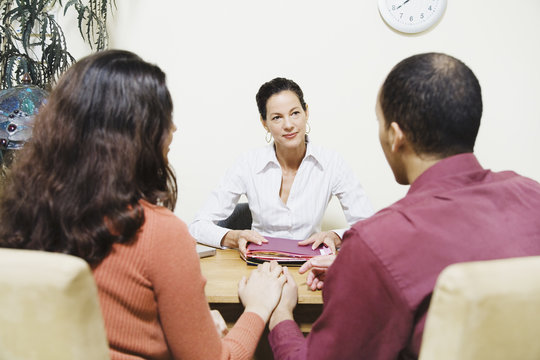 Mixed Race businesswoman talking to clients