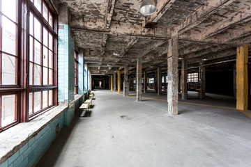 abandoned industrial interior with hall and big windows