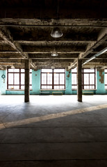 abandoned warehouse at factory with long hallway and big windows