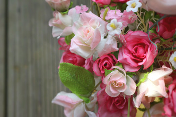 Beautiful vintage roses of artificial flowers