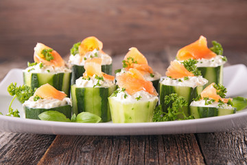 canape with cucumber,cheese and salmon