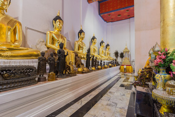 """Golden Buddha statue sit  respectively in temple names """"Wat Phra"""