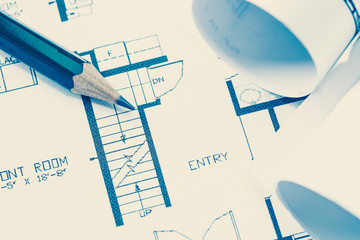 Wall Mural - Architect rolls and plans construction project drawing..