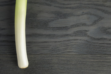 fresh organic leek on vintage oak table