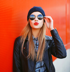 Portrait of fashionable blonde girl with red lipstick wearing a