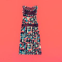 Fashionable ladies dress on bright background. Stylish print