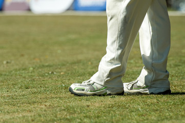 cricketer legs in traditional white trousers