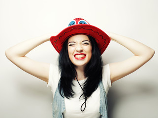Portrait of Trendy Hipster Girl in Red Hat