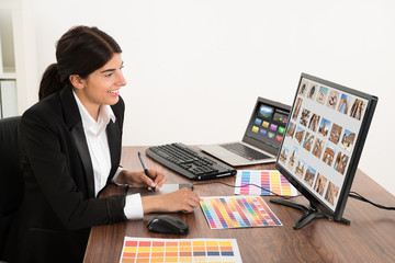 Female Graphic Designer In Office