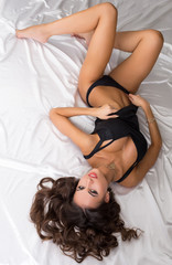 Image of enchanting model posing in lingerie lying