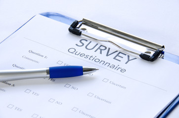 Generic survey questionnaire on clipboard with pen