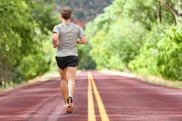 Male runner running on road training for fitness