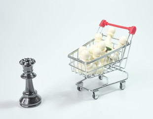 Black queen with white pawn inside trolley