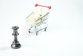 Black queen and white pawn inside trolley background