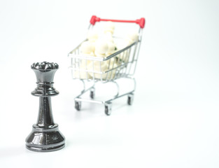 Black chess and white pawn inside toy trolley background