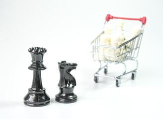 Black chess with white pawn inside toy trolley background