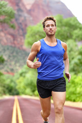 Sport and fitness runner man running on road
