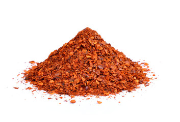 Powdered dried red pepper on white background