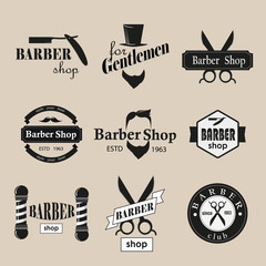 Retro barber shop logotypes set. Vector design elements.