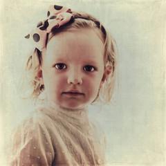 Portrait of beautiful little girl in vintage style.