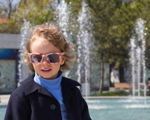 Beautiful little girl in sunglasses.