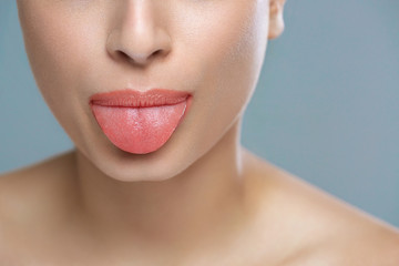 Young cheerful girl showing tongue