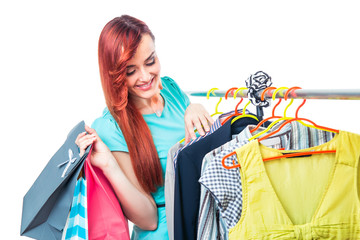 Young woman in boutigue with shopping bags