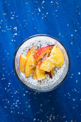 Coconut Milk Chia Seeds Pudding Served with Nectarine Slices
