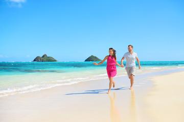 Beach happy couple on running having fun on Hawaii