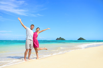 Wall Mural - Beach vacation happy carefree couple arms raised
