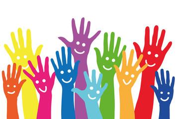 Bunte Hände mit Smiley als Hintergrund