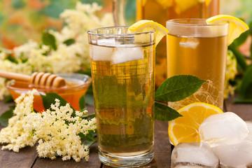 Homemade summer drink of elderflower with lemon and ice