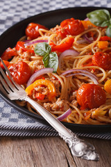 Pasta with minced meat and vegetables close up vertical