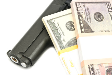 banknotes and gun on white