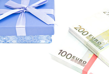 banknotes and blue gift box