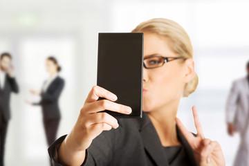 Businesswoman taking selfie