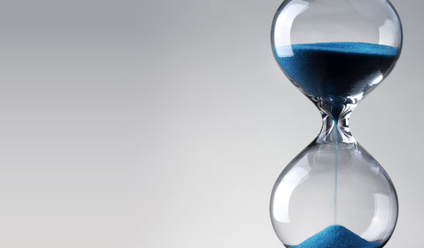 Time passing. Blue hourglass.