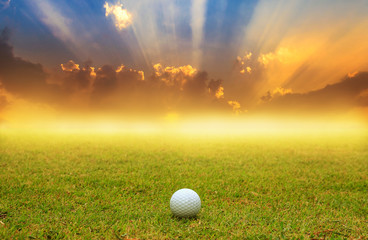golf ball in fairway on sunrise with fog