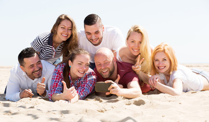 Friends photographed on the beach