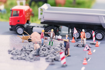 Road works with miniature figurines close-up