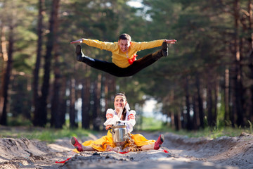 Beautiful womanl and man in a russian national dress outdoors