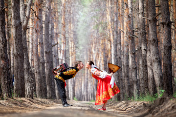 Beautiful womanl and man in a russian national dress