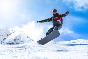 Keuken foto achterwand Wintersporten Jumping snowboarder from hill in winter